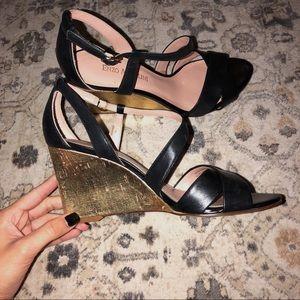 Enzo Angiolini gold wedged heels.